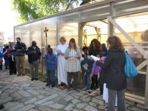 Blessing the new greenhouse and courtyard.