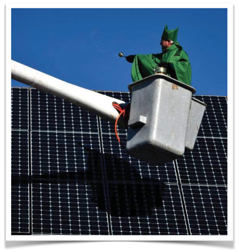 St. Andrew Episcopal Church in Framingham celebrated the church's new solar panels with Bishop Bud Cederholm blessing the panels via a cherry picker.
