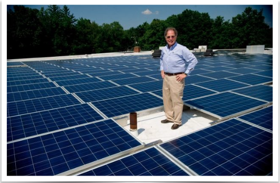Sylvan Pomerantz, President of Temple Beth El in Stamford, poses for a photo among new solar panels installed on the temple's roof on Tuesday, July 16, 2013. Photo: Lindsay Perry